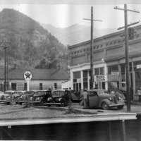 Cars are parked along Rose Street across from the Hamill Block in Georgetown, Colorado