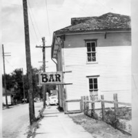 """St James Bar and Grill on Rose Street in Georgetown, Colorado, with canopy sign """"BAR"""""""